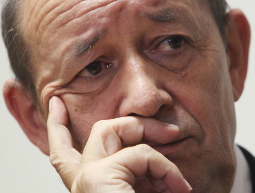 FILE - In this Monday, June 11, 2012 file photo, French Defense Minister Jean-Yves Le Drian listens to a question during a news conference in Kabul, Afghanistan. Le Drian said Saturday, Jan. 12, 2013, that a French soldier is missing after an unsuccessful commando raid in Somalia to rescue an intelligence agent who was killed by his captors during the fighting. (AP Photo/Musadeq Sadeq, File)