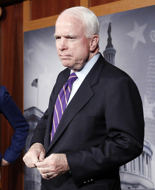 """FILE - In this Dec. 21, 2012, file photo, Sen. John McCain, R-Ariz., takes a question during a news conference on Capitol Hill in Washington. McCain responded with a flat out """"no"""" when asked Sunday, Jan. 13, 2013, on CBS' """"Face the Nation"""" whether Congress would pass a ban on assault weapons. (AP Photo/Ann Heisenfelt, File)"""