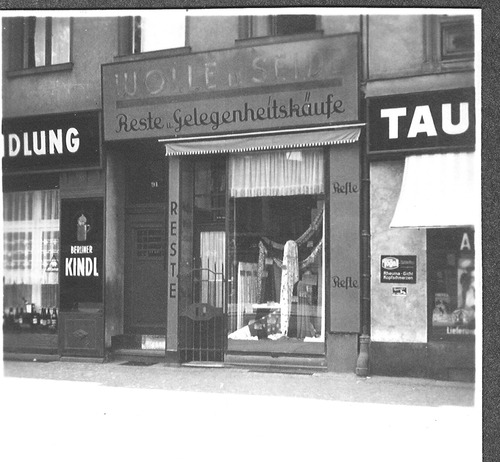 Courtesy Kurt. J. Linden The little store the Lindens opened in 1936 in Berlin, Germany. The header over the store indicates Reste (remnants), Gelegenheitskaufe (opportune bargains) and on top: woolen materials (fabrics).