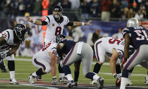 Houston Texans quarterback Matt Schaub (8) calls an audible during the first half of an AFC divisional playoff NFL football game against the New England Patriots in Foxborough, Mass., Sunday, Jan. 13, 2013. (AP Photo/Charles Krupa)