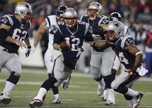 New England Patriots quarterback Tom Brady (12) hands off to Shane Vereen during the first half of an AFC divisional playoff NFL football game against the Houston Texans in Foxborough, Mass., Sunday, Jan. 13, 2013. (AP Photo/Charles Krupa)