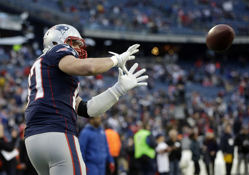 New England Patriots tight end Rob Gronkowski warms up before an AFC divisional playoff NFL football game against the Houston Texans in Foxborough, Mass., Sunday, Jan. 13, 2013. (AP Photo/Elise Amendola)