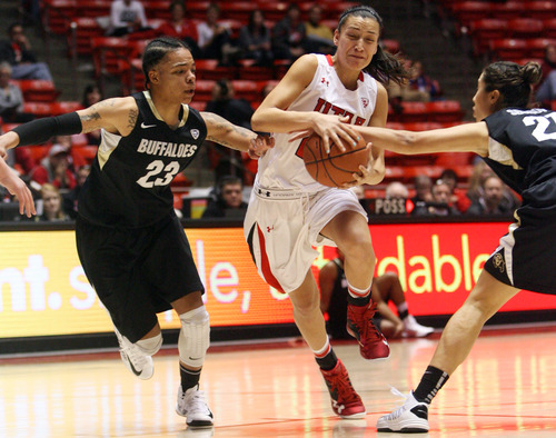 Kim Raff | The Salt Lake Tribune University of Utah player (middle) Danielle Rodriguez drives the basket past Colorado player (left) Chucky Jeffery and (right) Chelsea Bridgewater during a game at the Huntsman Center in Salt Lake City on January 13, 2013. Utah lost the game 43-56.