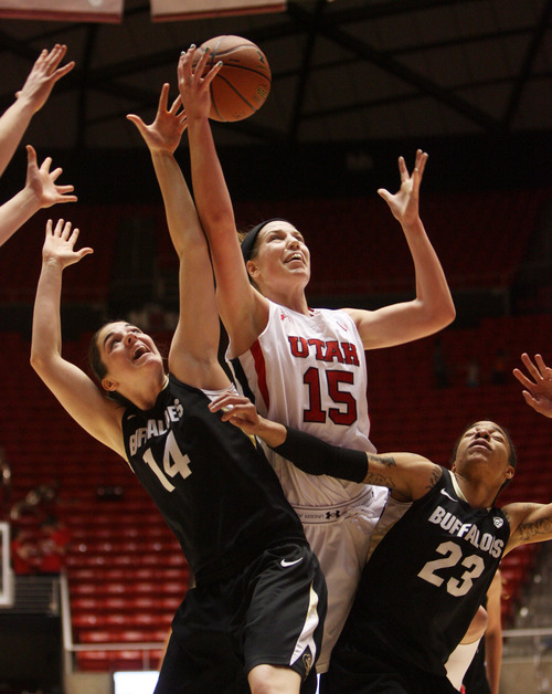 Kim Raff | The Salt Lake Tribune University of Utah player (middle) Michelle Plouffe competes with Colorado players (left) Meagan Malcolm-Peck and Chucky Jeffery for a rebound during a game at the Huntsman Center in Salt Lake City on January 13, 2013. Utah lost the game 43-56.