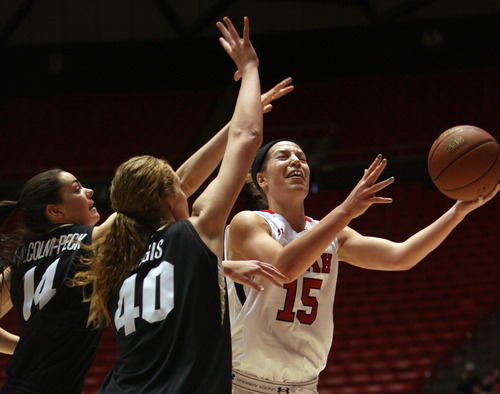 Kim Raff | The Salt Lake Tribune University of Utah player (right) Michelle Plouffe drives the basket past Colorado player (left) Meagan Malcolm-Peck and (middle) Rachel Hargis during a game at the Huntsman Center in Salt Lake City on January 13, 2013. Utah lost the game 43-56.
