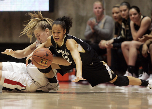Kim Raff | The Salt Lake Tribune University of Utah player (left) Taryn Wicijowski competes with Colorado player Arielle Roberson for a loose ball during a game at the Huntsman Center in Salt Lake City on January 13, 2013. Utah lost the game 43-56.