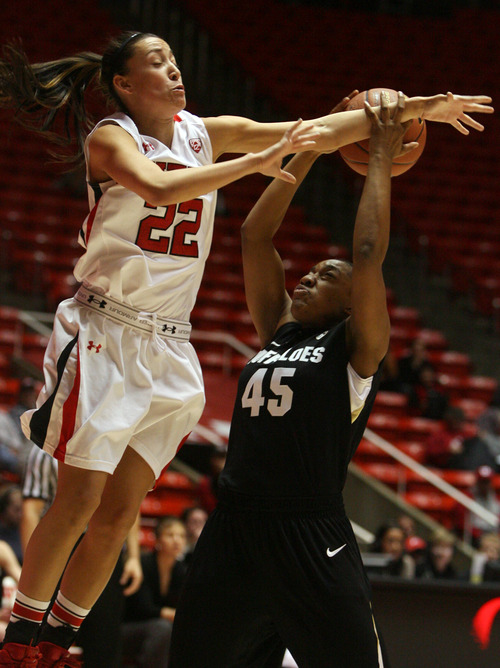 Kim Raff | The Salt Lake Tribune University of Utah player (left) Danielle Rodriguez competes with Colorado player Kyleesha Weston for a rebound during a game at the Huntsman Center in Salt Lake City on January 13, 2013. Utah lost the game 43-56.