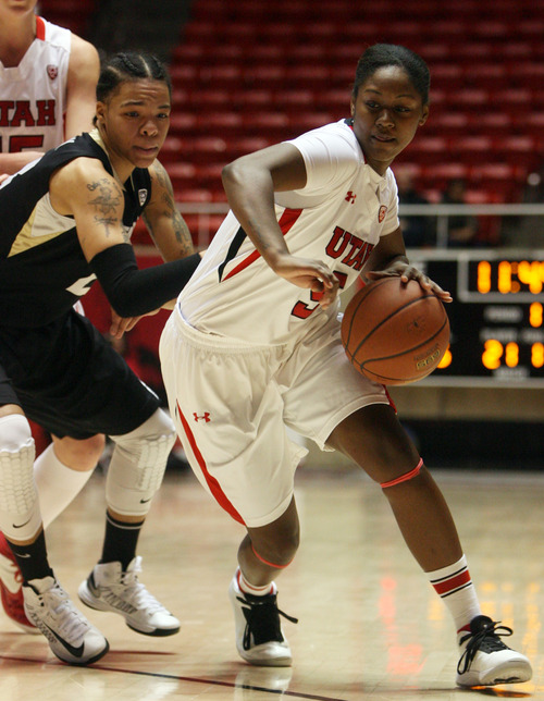 Kim Raff | The Salt Lake Tribune University of Utah player (right) Cheyenne Wilson drives the basket past Colorado player Chucky Jeffery during a game at the Huntsman Center in Salt Lake City on January 13, 2013. Utah lost the game 43-56.