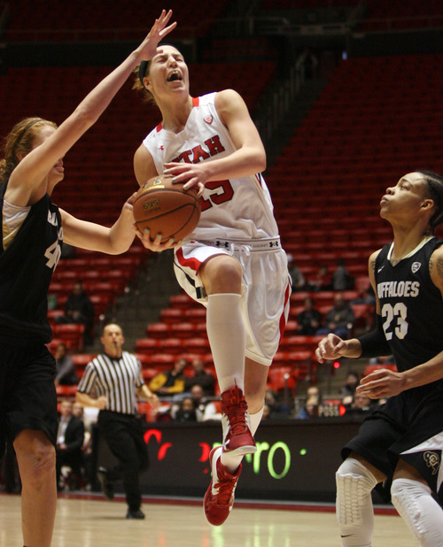 Kim Raff | The Salt Lake Tribune University of Utah player (middle) Michelle Plouffe attempts a layup as Colorado players (left) Rachel Hargis and (right) Chucky Jeffery defend during a game at the Huntsman Center in Salt Lake City on January 13, 2013. Utah lost the game 43-56.