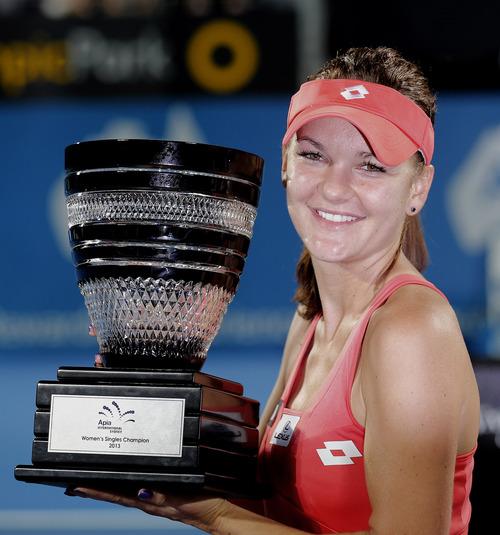 Poland's Agnieszka Radwanska holds the winner's trophy after defeating Slovakia's Dominika Cibulkova in their women's final match at the Sydney International Tennis tournament in Sydney, Australia, Friday, Jan. 11, 2013. Radwanska won 6-0, 6-0. (AP Photo/Rob Griffith)