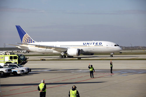 HOLD FOR RELEASE UNTIL 12:01 a.m. CST, MONDAY, JAN. 14, 2013. THIS STORY MAY NOT BE POSTED ONLINE, BROADCAST OR PUBLISHED BEFORE 12:01 a.m. CST - In this Sunday, Nov. 4, 2012 photo, a United Airlines 787 Dreamliner arrives at O'Hare international Airport in Chicago, from Houston. The Regional Transportation Authority says it will file a lawsuit Monday, Jan. 14, 2013, alleging that United Airlines subsidy United Aviation Fuels is falsely claiming to buy jet fuel out of a small office in a rural Illinois community to avoid paying tens of millions of dollars in taxes in Chicago, where the purchases are allegedly being made. (AP Photo/Nam Y. Huh)