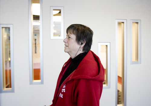 Kim Raff     The Salt Lake Tribune Catherine Barnhart walks on the indoor track at the Millcreek Recreation Center in Salt Lake City on January 4, 2013. Barnhart is a 15-year patient of Beth Hanlon, a doctor with MDVIP, a concierge model where patients pay an upfront retainer for the privilege of having round-the-clock access. Under Hanlon's coaching Barnhart has lost 35 pounds in a year.