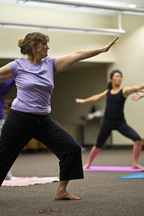 Chris Detrick  |  The Salt Lake Tribune Dr. Beth Hanlon practices yoga at Salt Lake Regional Hospital Thursday January 10, 2013. Hanlon, a doctor who a year ago started a concierge practice, is joining forces with Salt Lake Regional Medical Center's WOW (Women of Wellness) program to provide yoga and zumba classes for her patients.