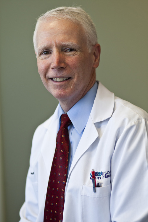 Chris Detrick     The Salt Lake Tribune Dr. Michael Jennings, M.D. poses for a portrait in his office Wednesday January 9, 2013.  Tired of assembly-line medicine and the headaches of dealing with insurance companies, Jennings, 63, stopped accepting insurance in 2009. He opened a new practice where, for an annual flat rate, patients can see him as often as needed.