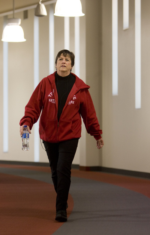 Kim Raff  |  The Salt Lake Tribune Catherine Barnhart walks on the indoor track at the Millcreek Recreation Center in Salt Lake City on January 4, 2013. Barnhart is a 15-year patient of Beth Hanlon, a doctor with MDVIP, a concierge model where patients pay an upfront retainer for the privilege of having round-the-clock access. Under Hanlon's coaching Barnhart has lost 35 pounds in a year.