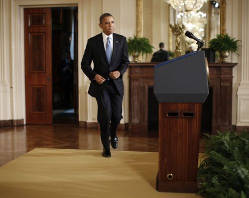 President Barack Obama walks towards the podium before speaking about the debt limit in the East Room of the White House in Washington, Monday, Jan. 14, 2013.  (AP Photo/Pablo Martinez Monsivais)