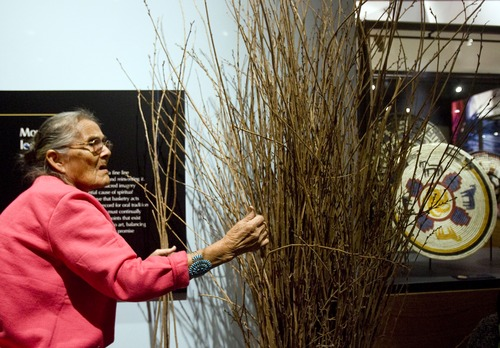 "Kim Raff  |  The Salt Lake Tribune Navajo artist Mary Holiday Black selects sumac branches to weave during a basket weaving demostration at ""A Celebration of Contemporary Navajo Baskets"" exhibit, which opened at the Natural History Museum of Utah in Salt Lake City on January 12, 2013. The exhibit features more than 150 works of art created by the basket weavers of Monument Valley, Utah. Black is considered the matriarch of the Navajo basket revolution."