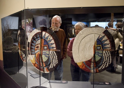 "Kim Raff  |  The Salt Lake Tribune Rick and Judy Cohen look at Elsie Holiday's Changing Women Series on display in ""A Celebration of Contemporary Navajo Baskets"" exhibit, which opened at the Natural History Museum of Utah in Salt Lake City on January 12, 2013. The exhibit features more than 150 works of art created by the basket weavers of Monument Valley, Utah."
