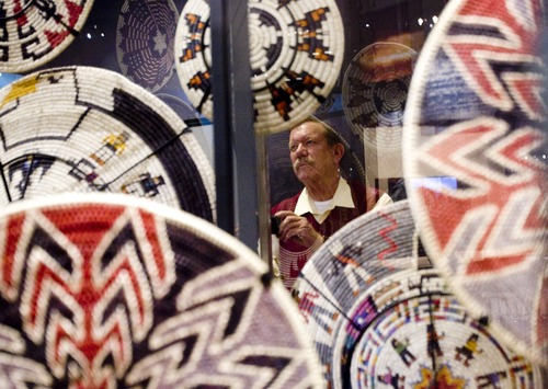 "Kim Raff  |  The Salt Lake Tribune Johnny Foulger looks at a large display of Navajo baskets in ""A Celebration of Contemporary Navajo Baskets"" exhibit, which opened at the Natural History Museum of Utah in Salt Lake City on January 12, 2013. The exhibit features more than 150 works of art created by the basket weavers of Monument Valley, Utah."