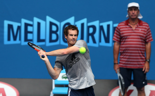Britain's Andy Murray makes a backhand as his coach Ivan Lendl looks on during a practice session at Melbourne Park ahead of the Australian Open tennis championship in Melbourne, Australia, Saturday, Jan. 12, 2013. (AP Photo/Dita Alangkara)