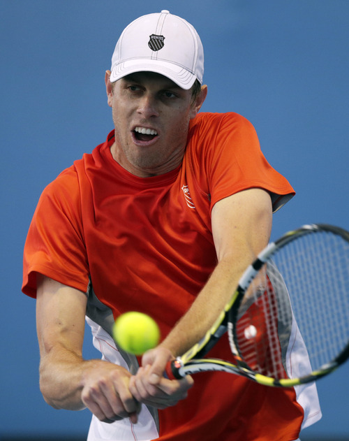 Sam Querry of the US hits a return to Spain's Daniel Munoz-De La Nava during their first round match at the Australian Open tennis championship in Melbourne, Australia, Monday, Jan. 14, 2013. (AP Photo/Andy Wong)