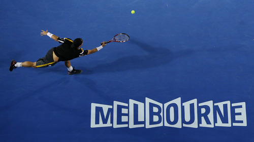 Australia's Lleyton Hewitt reaches for a forehand return to Serbia's Janko Tipsarevic during their first round match at the Australian Open tennis championship in Melbourne, Australia, Monday, Jan. 14, 2013. (AP Photo/Aaron Favila)