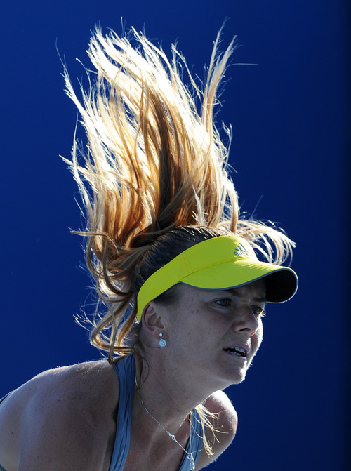 Slovakia's Daniela Hantuchova serves to Taiwan's Chan Yung-Jan during their first round match at the Australian Open tennis championship in Melbourne, Australia, Monday, Jan. 14, 2013. (AP Photo/Andrew Brownbill)