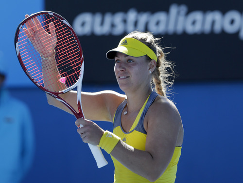 Germany's Angelique Kerber celebrates after winning her first round match against Ukraine's Elina Svitolina at the Australian Open tennis championship in Melbourne, Australia, Monday, Jan. 14, 2013. (AP Photo/Andy Wong)