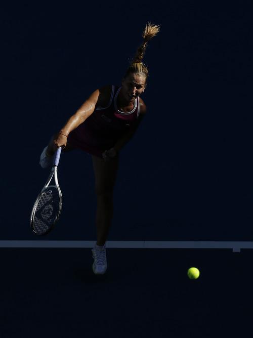 Slovakia's Dominika Cibulkova serves to Australia's Ashley Barty  during their first round match at the Australian Open tennis championship in Melbourne, Australia, Monday, Jan. 14, 2013. (AP Photo/Rob Griffith)