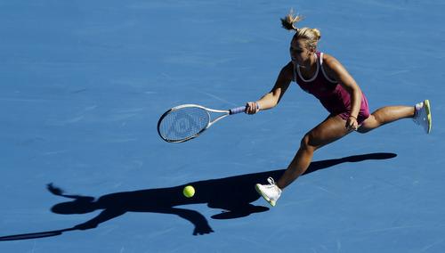Slovakia's Dominika Cibulkova makes a forehand return to Australia's Ashley Barty  during their first round match at the Australian Open tennis championship in Melbourne, Australia, Monday, Jan. 14, 2013. (AP Photo/Rob Griffith)
