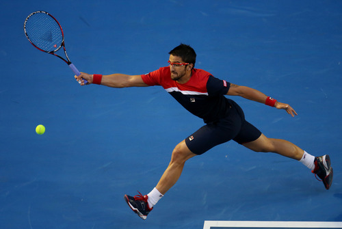 Serbia's Janko Tipsarevic makes a forehand return to Australia's Lleyton Hewitt during their first round match at the Australian Open tennis championship in Melbourne, Australia, Monday, Jan. 14, 2013. (AP Photo/Aaron Favila)