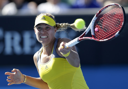 Germany's Angelique Kerber makes forehand return to Ukraine's Elina Svitolina during their first round match at the Australian Open tennis championship in Melbourne, Australia, Monday, Jan. 14, 2013. (AP Photo/Andy Wong)