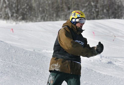 Scott Sommerdorf   |  The Salt Lake Tribune Javan Padilla of Orem, Utah, yells after hitting his landing during the Open Division of the Recon Tour Snowboard competition at Park City Mountain Resort, Sunday, January 13, 2013.