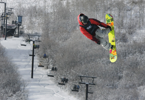 Scott Sommerdorf   |  The Salt Lake Tribune Max Raymer of Park City jumps during the Open Division of the Recon Tour Snowboard competition at Park City Mountain Resort, Sunday, January 13, 2013.