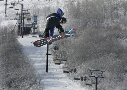 Scott Sommerdorf   |  The Salt Lake Tribune Josh Glen Crisp of Kamas, Utah, jumps during the Open Division of the Recon Tour Snowboard competition at Park City Mountain Resort, Sunday, January 13, 2013.