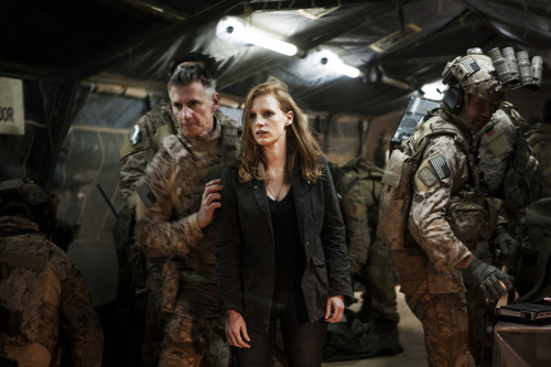 """In this undated publicity photo released by Columbia Pictures Industries, Inc., Jessica Chastain, center, plays a member of the elite team of spies and military operatives, stationed in a covert base overseas, with Christopher Stanley, left, and Alex Corbet Burcher, right, who secretly devote themselves to finding Osama Bin Laden in Columbia Pictures' new thriller, """"Zero Dark Thirty."""" Best-picture prospects for Oscar Nominations on Thursday, Jan. 10, 2013, include """"Zero Dark Thirty,"""" directed by Kathryn Bigelow. (AP Photo/Columbia Pictures Industries, Inc., Jonathan Olley)"""