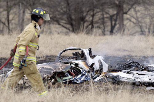 A firefighter walks past the wreckage of a Piper PA46 that crashed Saturday, Jan. 12, 2013, near Glory, Texas. The crash killed Utahns Michael Dale Bradley, 44, and Michael Endo, 51, both of Salt Lake City, and the pilot, 49-year-old Rob Thompson, of Saratoga Springs. Courtesy Sam Craft  |  The Paris (Texas) News.
