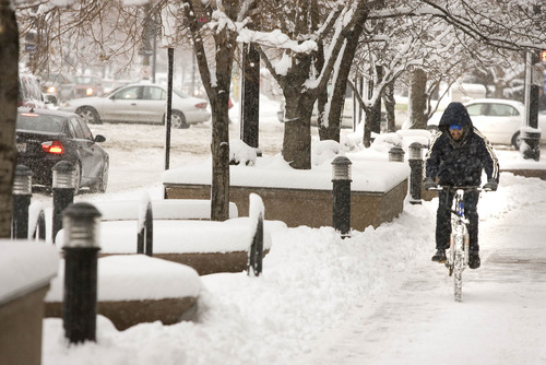 Paul Fraughton  |   The Salt Lake Tribune A cyclist makes his way down the sidewalk in front of the federal courthouse in Salt Lake City on Friday, Jan. 11, 2013.