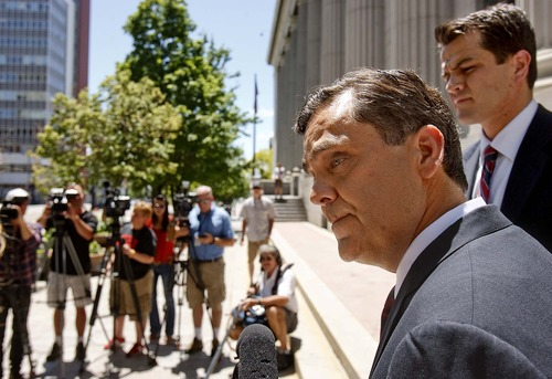 Trent Nelson  |  The Salt Lake Tribune Attorney Jonathan Turley answers questions on the steps of the U.S. District Court about his filing challenging Utah's law against polygamy on behalf of the Kody Brown family, in Salt Lake City, Utah, Wednesday, July 13, 2011. At right rear is attorney Adam Alba.