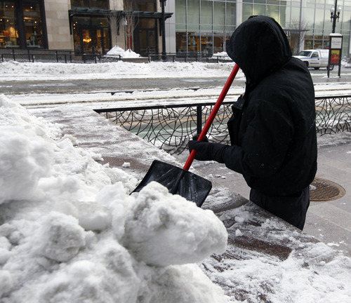 Al Hartmann  |  The Salt Lake Tribune A maintainence worker chips away at last week's snow along Main Street in Salt Lake City on Monday, Jan. 14, the coldest morning of the year. It was about 2 degrees at 8:30 a.m.