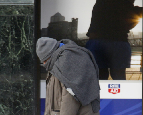 Al Hartmann  |  The Salt Lake Tribune A man in coat and hat and wrapped in a blanket walks along Main Street on Monday, Jan. 14, the coldest morning of the year. It was just above zero at 8:30 a.m.