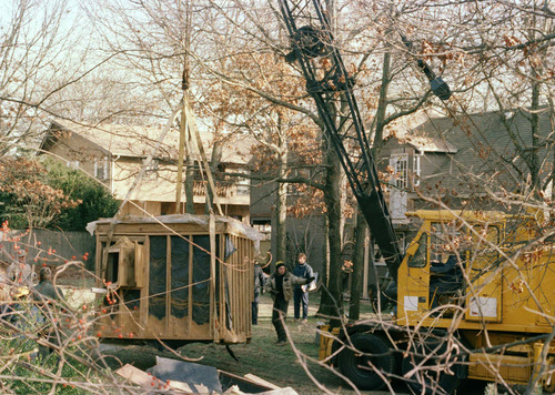 """FILE - In a Jan. 18, 1993 file photo, a 30-foot-high crane raises the bunker out of the earth from the property of John Esposito in Bay Shore, N.Y. The cement and wood bunker, which contains a trap door, is 6 feet by 9 feet. Esposito is charged with keeping 10-year-old Katie Beers imprisoned in the bunker for 16 days. On the 20th anniversary of her ordeal, Beers has co-written a book with a television reporter who covered her kidnapping. """"Buried Memories: Katie Beers' Story"""" (Title Town Publishing) has a happy ending. (AP Photo/Michael Alexander, File)"""