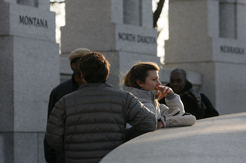 Scott Sommerdorf   |  The Salt Lake Tribune Visitors to the World War II Memorial pause to take in the sight. A tour of D.C. for travelers from Utah, Friday, January 4, 2013.