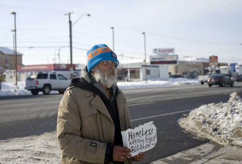 Kim Raff | The Salt Lake Tribune Stephen Hobbs, who is homeless, braves the frigid temperatures while panhandling on 500 South in Salt Lake City on Monday, Jan. 14, 2013.