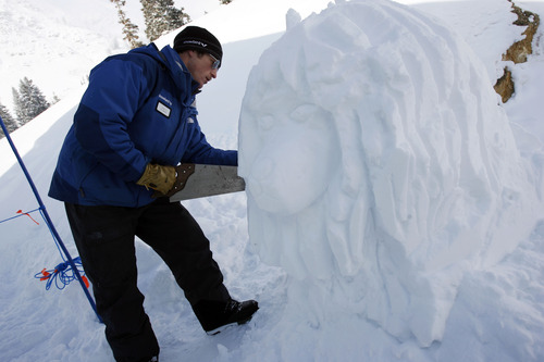 Francisco Kjolseth  |  The Salt Lake Tribune Snowbird lift operator John Steinbacher puts the finishing touches on a snow lion while working in frigid temperatures on Monday, January 14, 2013.