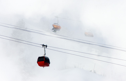 Steve Griffin | The Salt Lake Tribune  Skiers brave sub-zero temperatures as a gondola passes through clouds of man-made snow at the Canyons Resort in Park City on Monday January 14, 2013.