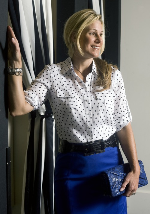 Kim Raff   The Salt Lake Tribune Day wear/work wear: Model Jennifer Ebeling wears a polka dot silk camp shirt ($98), Sapphire perfect form pencil skirt ($88), Zebra Ladylike heel ($128), Sapphire snake-embossed clutch ($68), Double buckle stretch belt ($48), Crystal pave pendant necklace ($34), Silvertone link bracelet ($38) and Silvertone crystal stretch bracelet ($48), and Pave crystal double hoop earrings ($28). (All clothing from the Fashion Place Mall's White House Black Market store.)