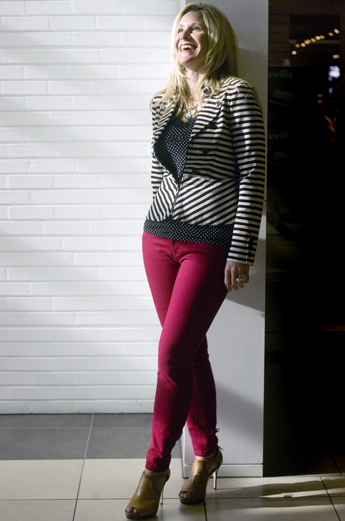 Kim Raff   The Salt Lake Tribune Dressy casual: Model Jennifer Ebeling wears a ponte knit jacket ($138) instead of a sweatshirt, with a stylish striped pattern, collar detail and peplum. Colored jeans with stretch (Blanc cardinal red slim jeans, $49) have flexibility and provide a great fit, and can be dressed up with heels (Vachetta peeptoe tan shoe, $138), or dressed down with flats. (All clothing and accessories from Fashion Place Mall's White House Black Market store.)