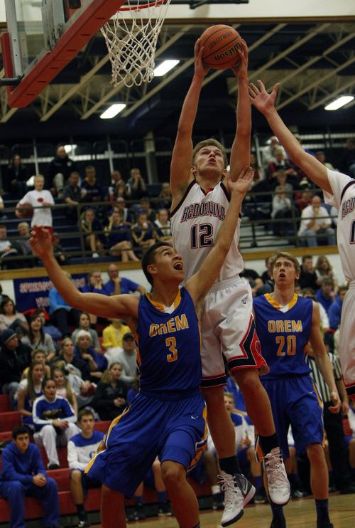 Chris Detrick     The Salt Lake Tribune Springville's Ben Johnson (12) grabs a rebound over Orem's Quinn Peters (3) during the game at Springville High School Friday January 11, 2013.