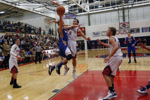 Chris Detrick     The Salt Lake Tribune Orem's Zach Hunsaker (2) shoots past Springville's Max Schreiner (5) during the game at Springville High School Friday January 11, 2013. Orem won the game 74-54.